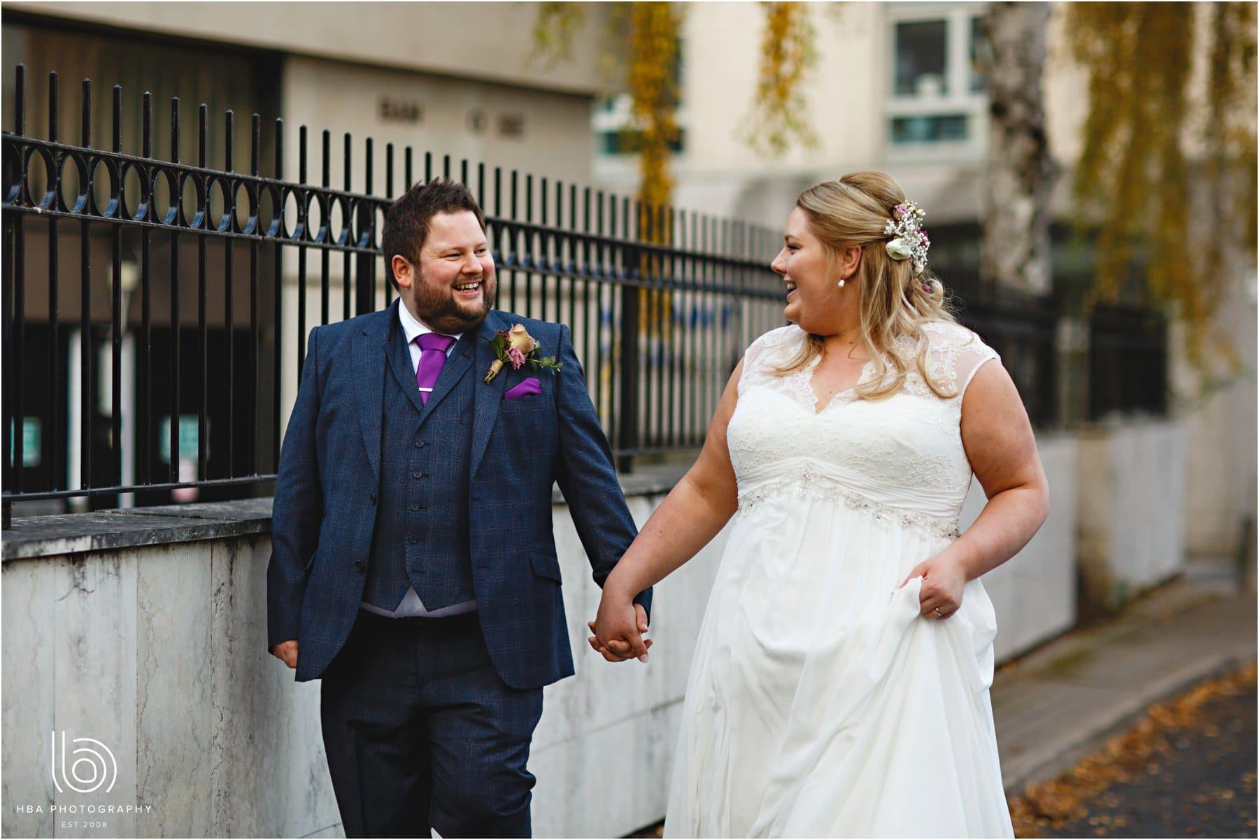 The bride & groom walking along