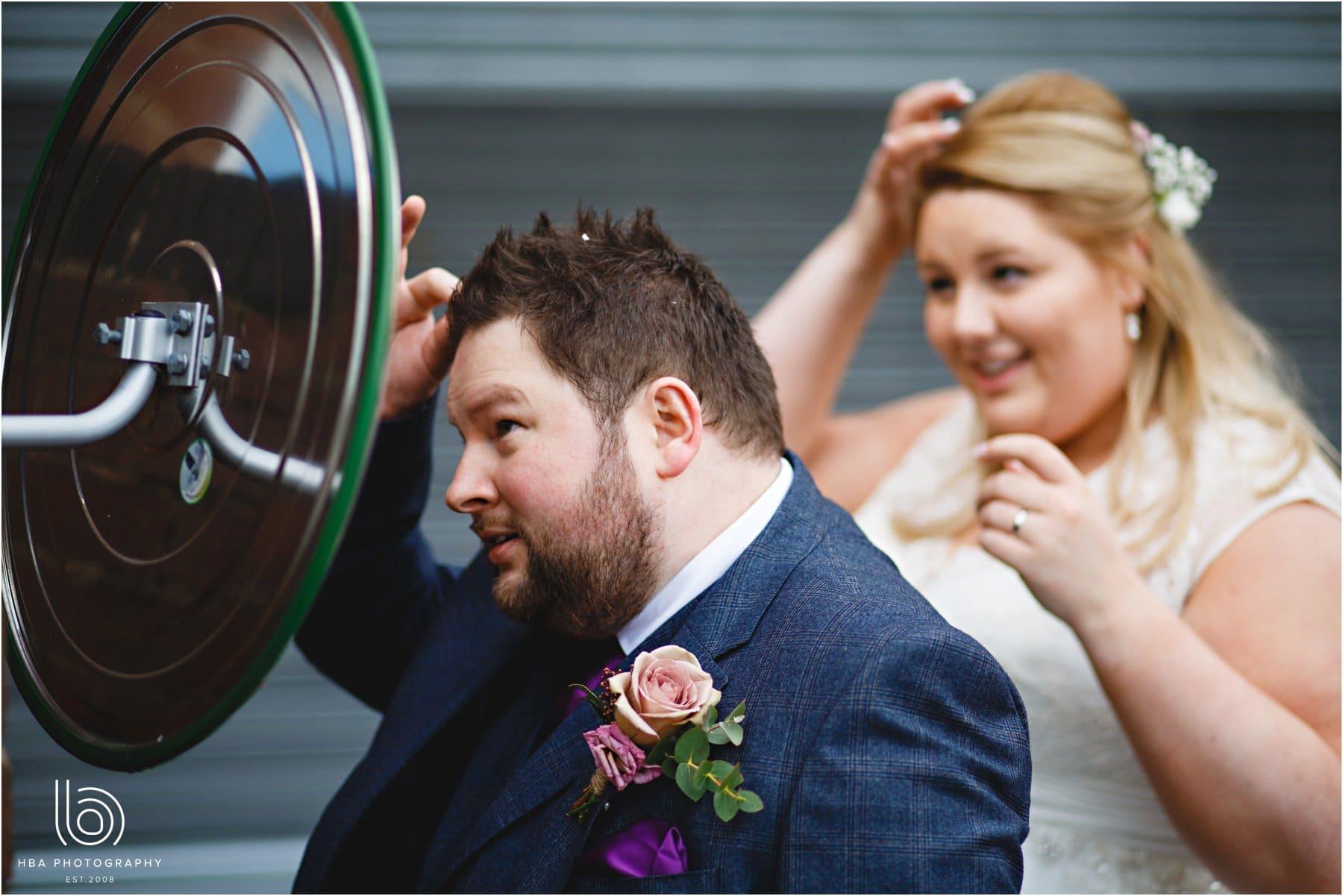 The bride & groom doing their hair
