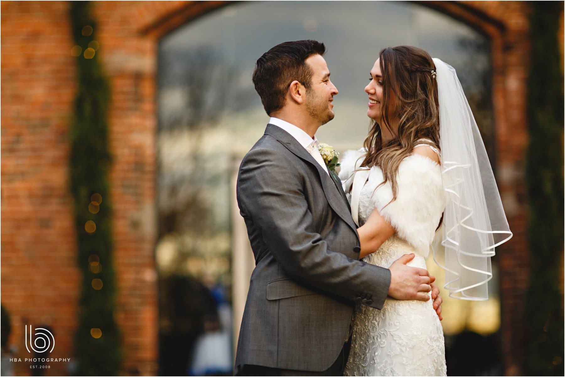 the bride & groom outside shustoke farm barns