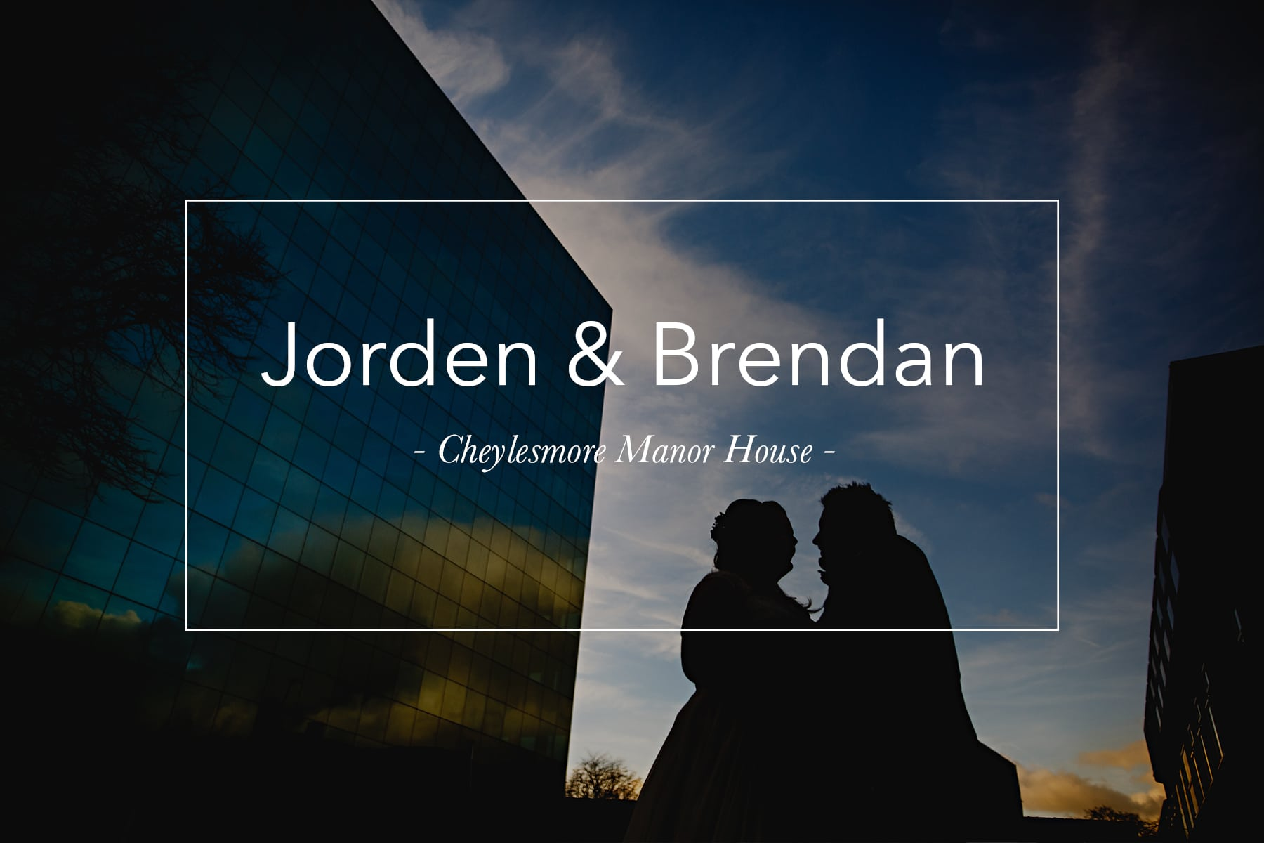 the bride and groom stood by a blue glass building