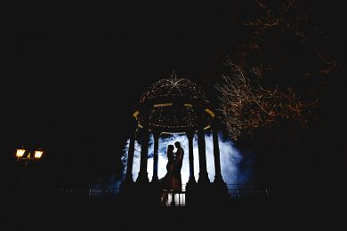 the bride and groom stood in blue smoke at weston hall