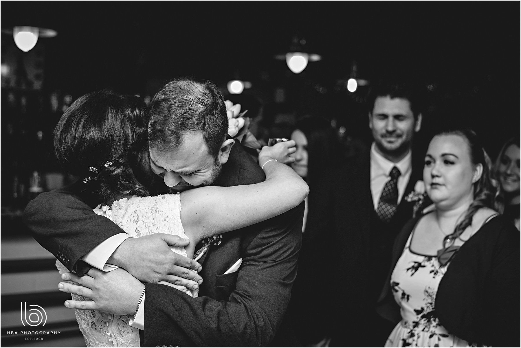 Brother of the bride hugging