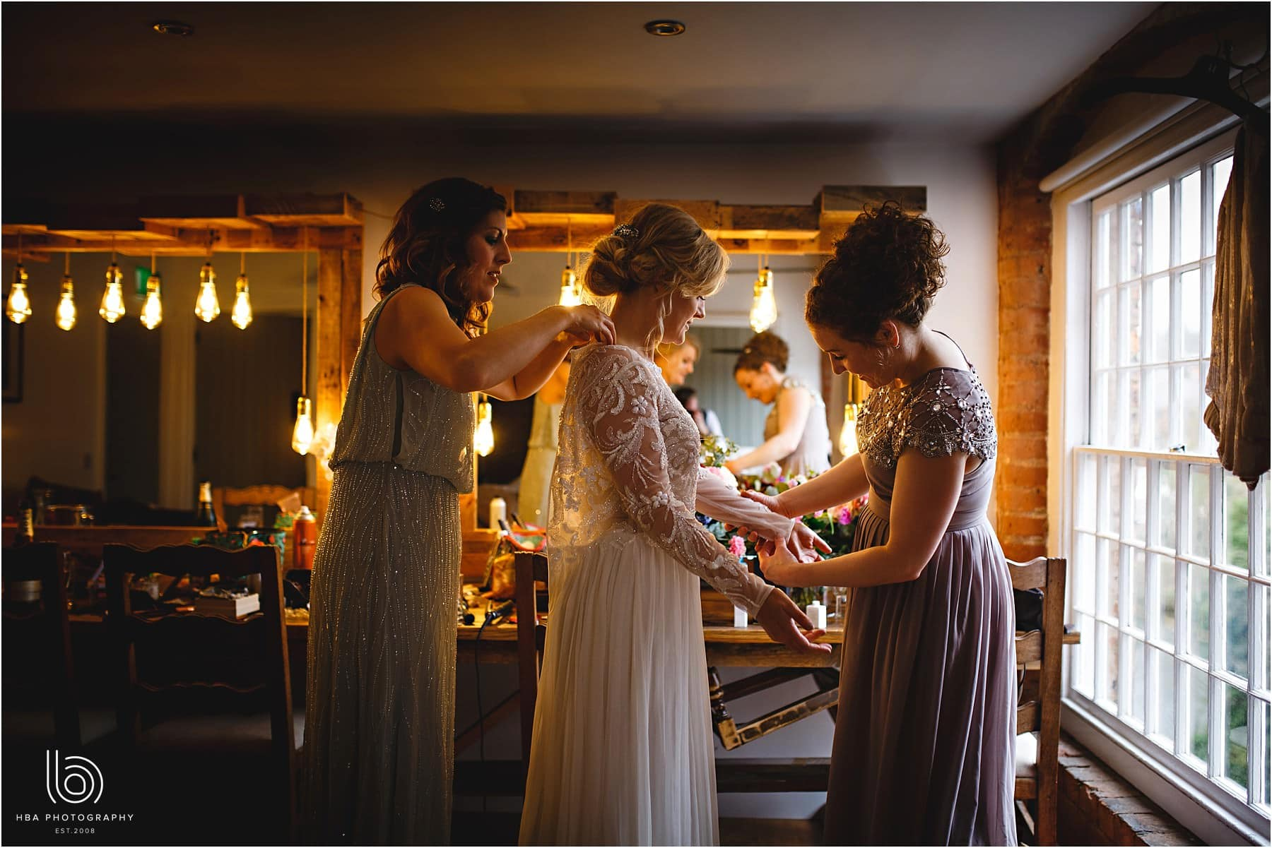 the bride and her bridemaids getting ready