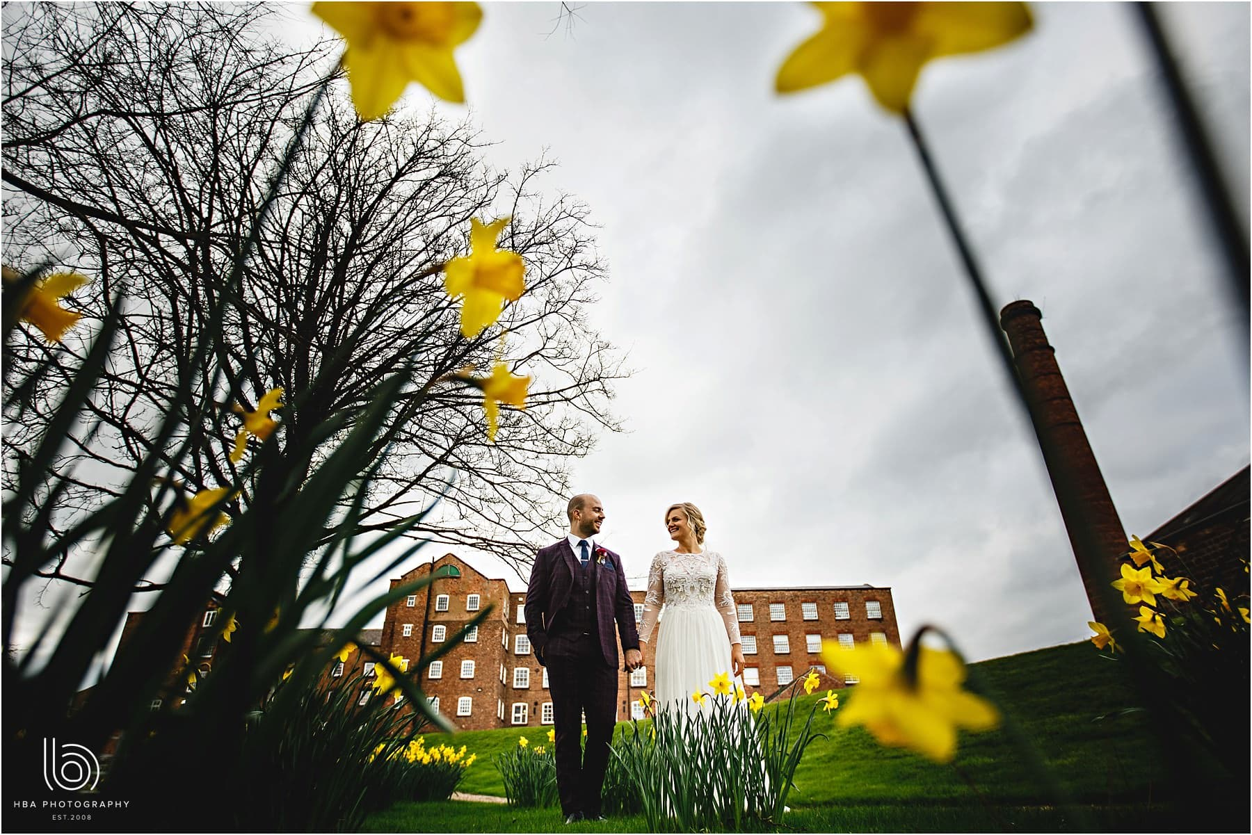 the bride & groom in the daffodils