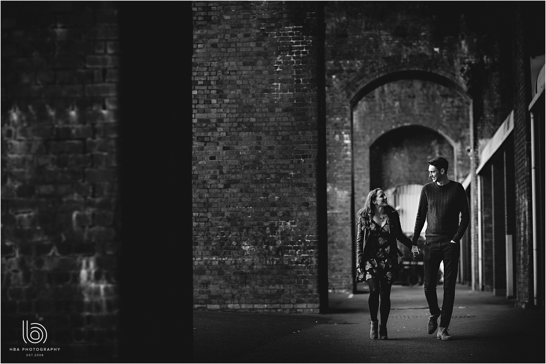 Black and white photo under the arches in the city
