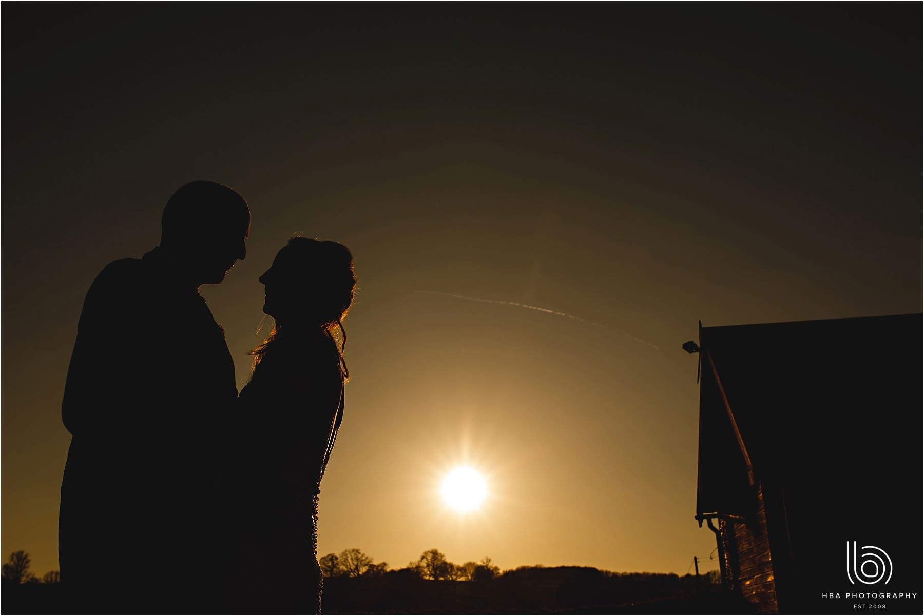 the bride and groom in the sunset