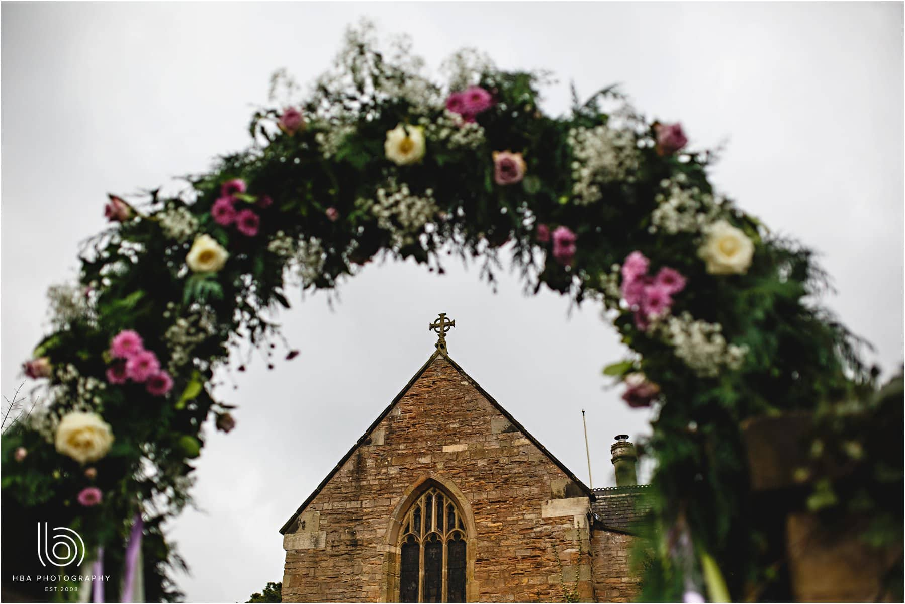 a flower arch at the church