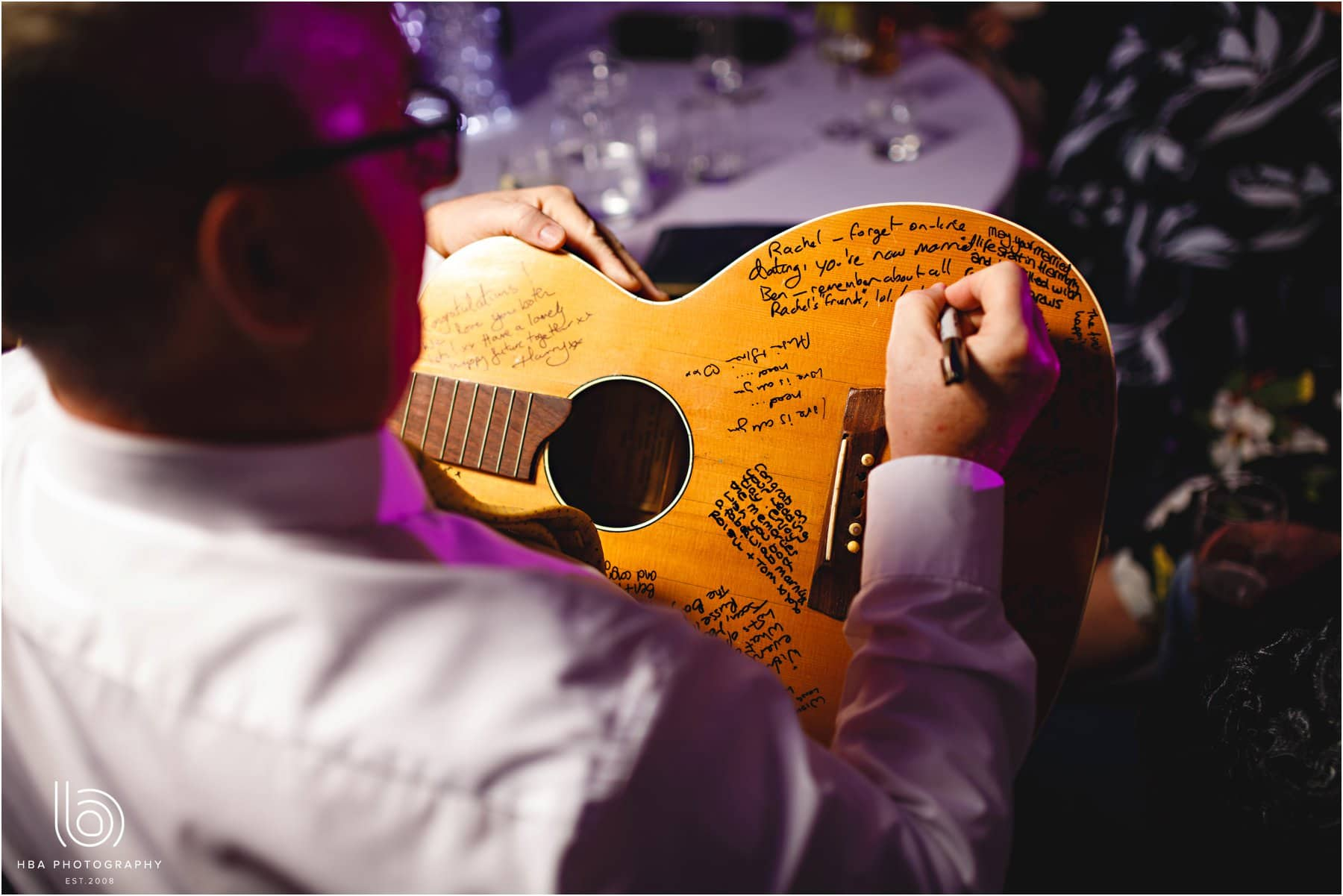 everyone signing the guest book guitar