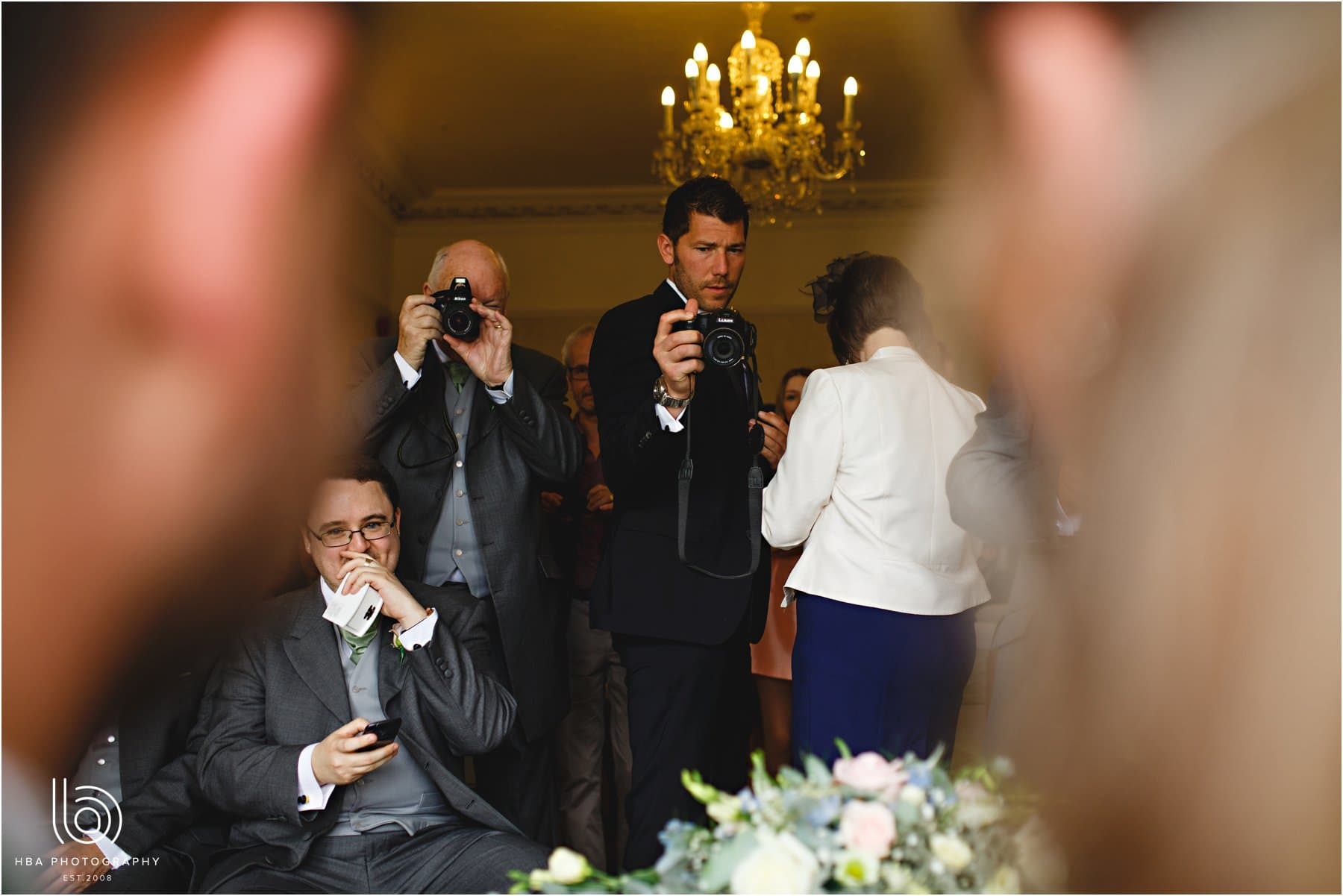 the wedding guests taking photos