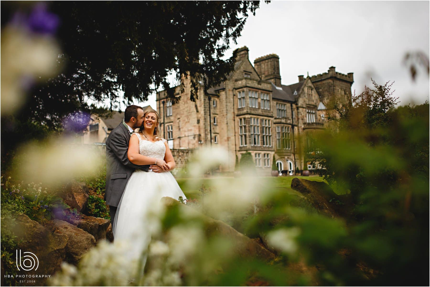 the bride and groom infront of Breadsall priory