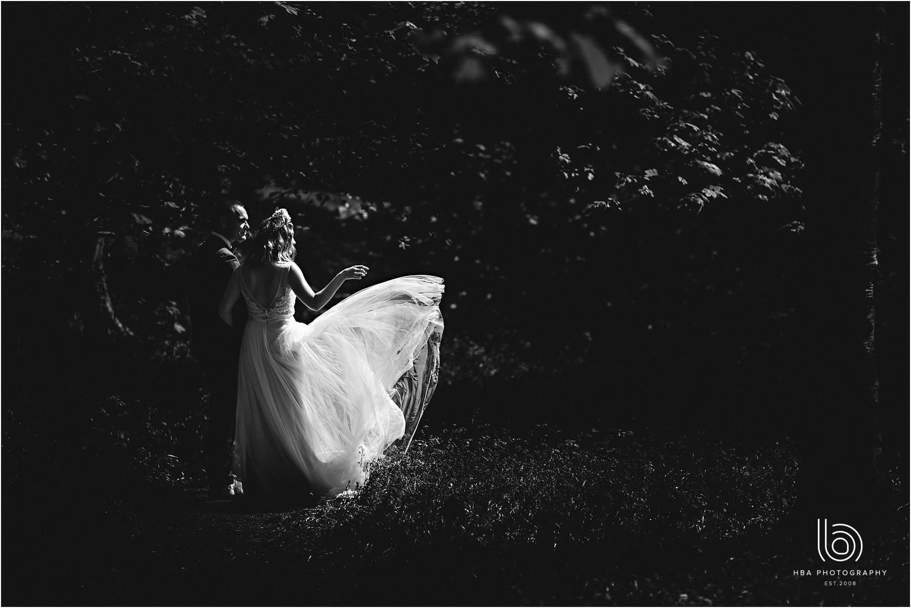 bride and groom in the woods at yoxall bluebell woods