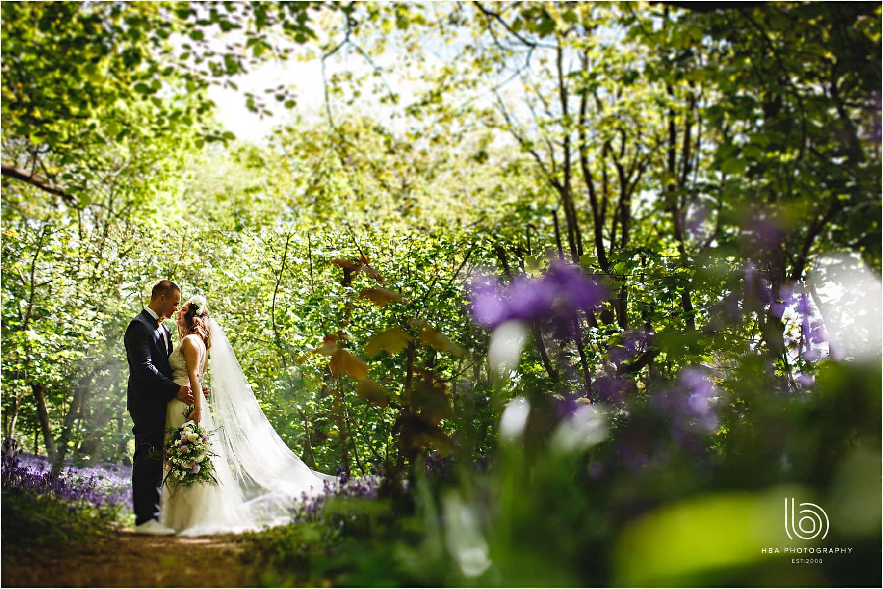 the bride and groom together in the woods