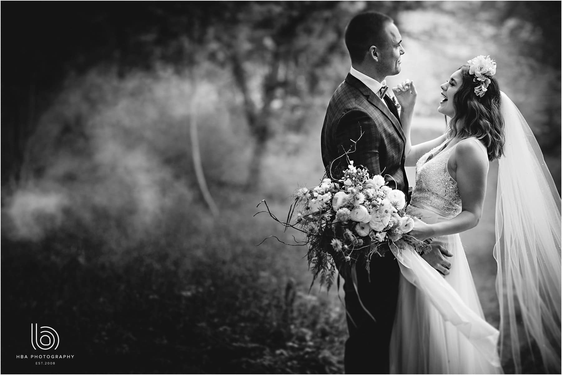 black and white bride and groom in the misty woods wedding day