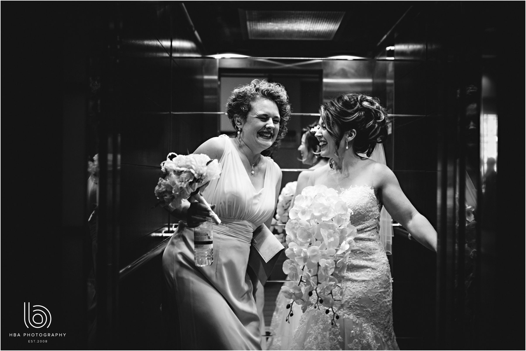 the bride and her maid of honour in the lift