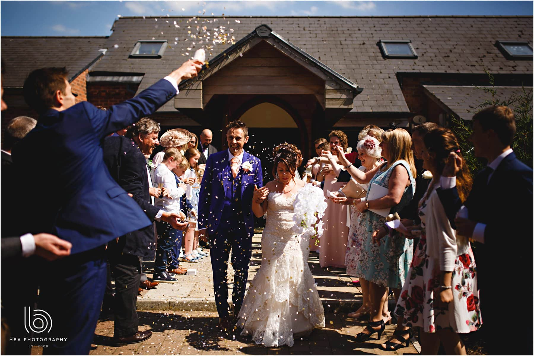 the bride & groom getting covered in confetti