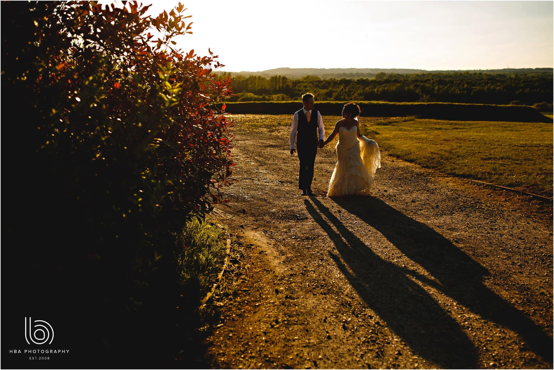 the bride & groom in the evning sun