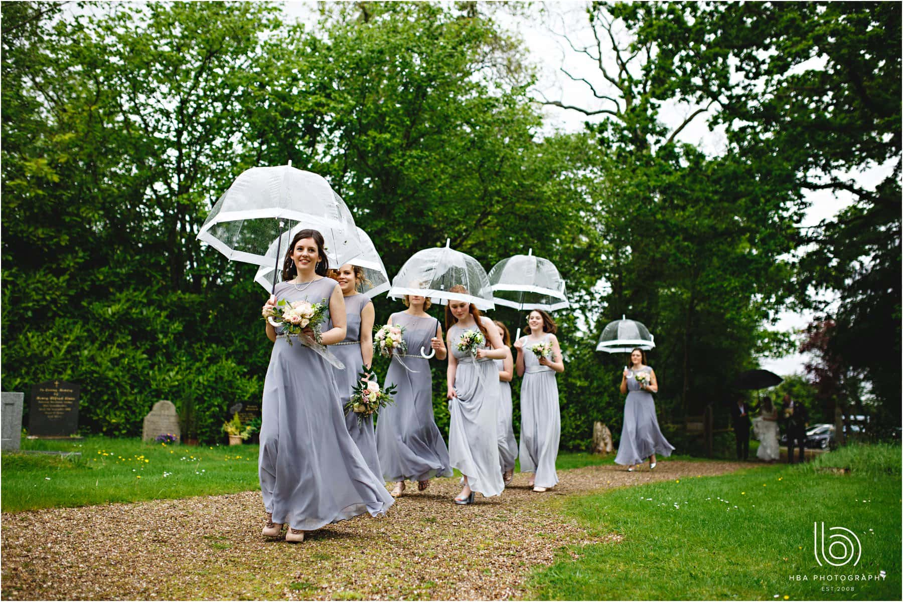 the bridesmaids walking to the church