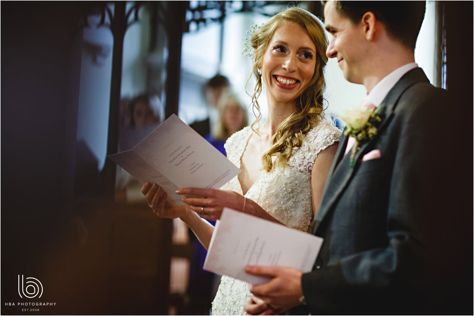 The bride smiling during the ceremony