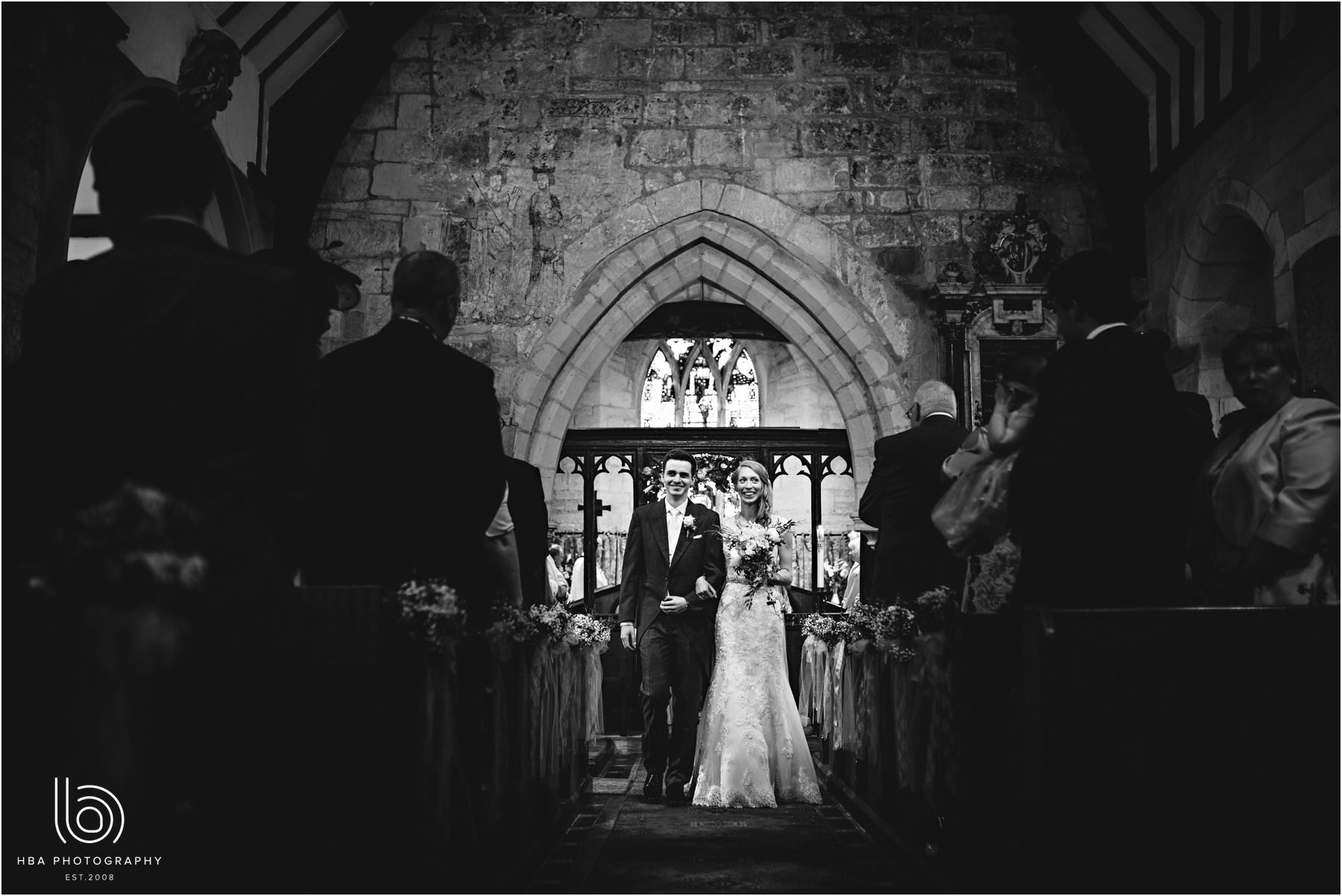 the bride & groom walking down the aisle