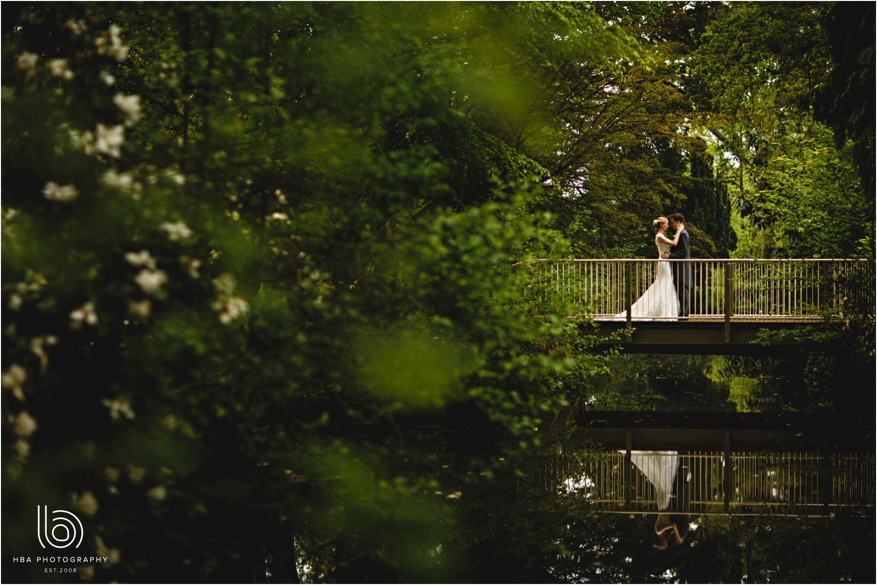 the bride & groom by the lake