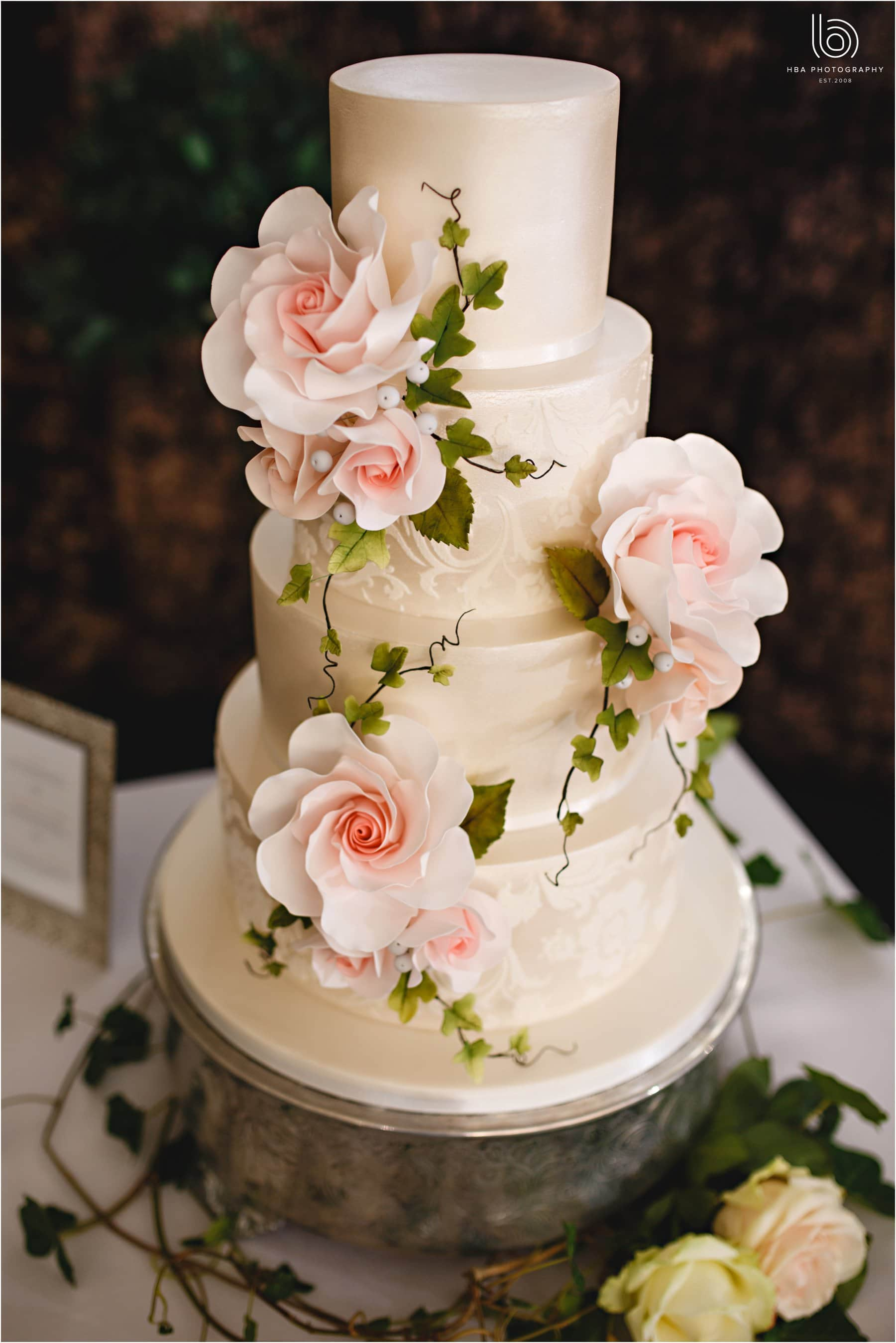 the wedding cake with pink flowers