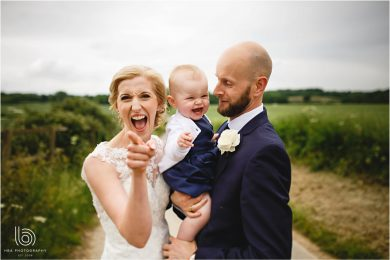 the bride & groom and their gorgeous daughter