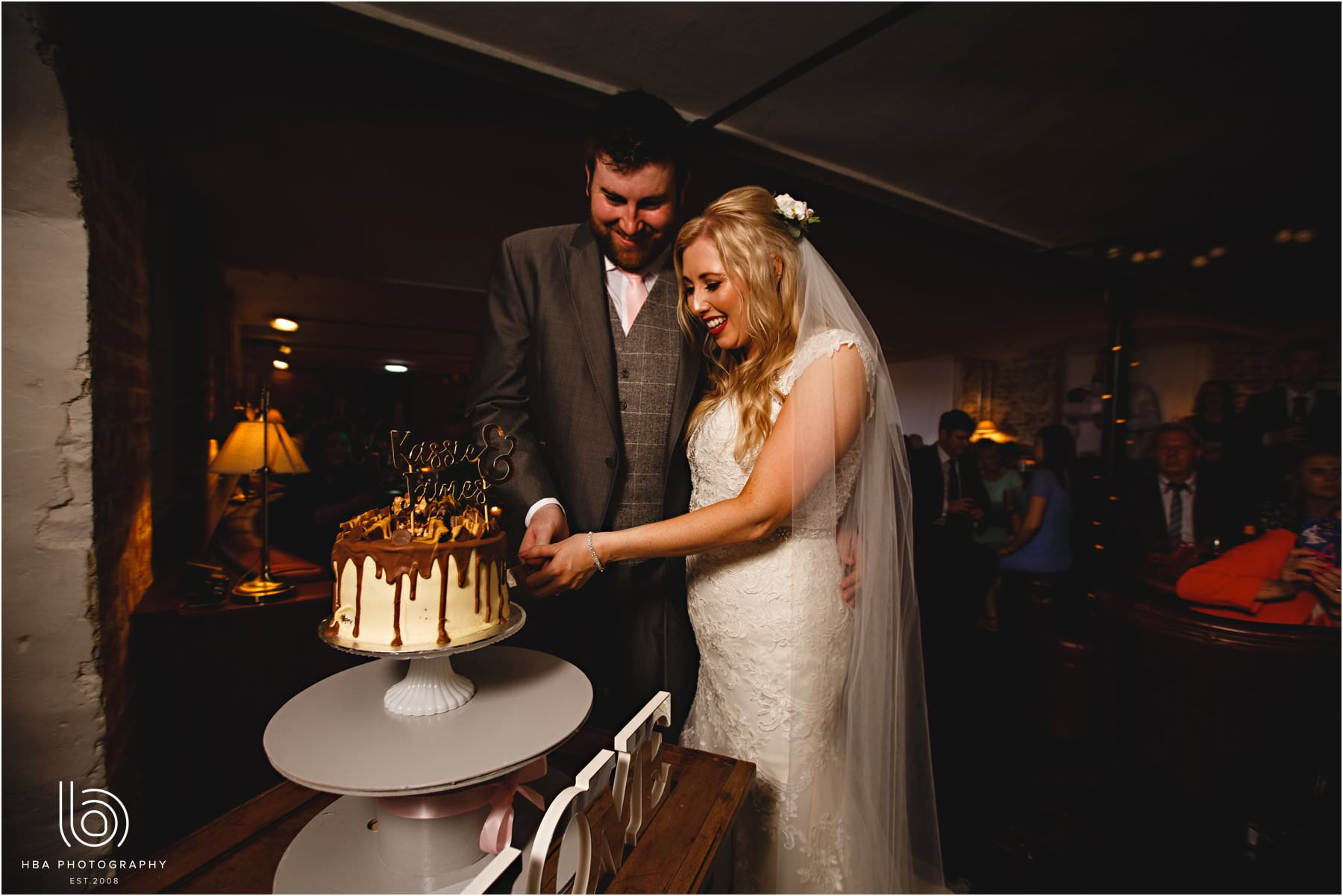 the bride & groom cutting their cake