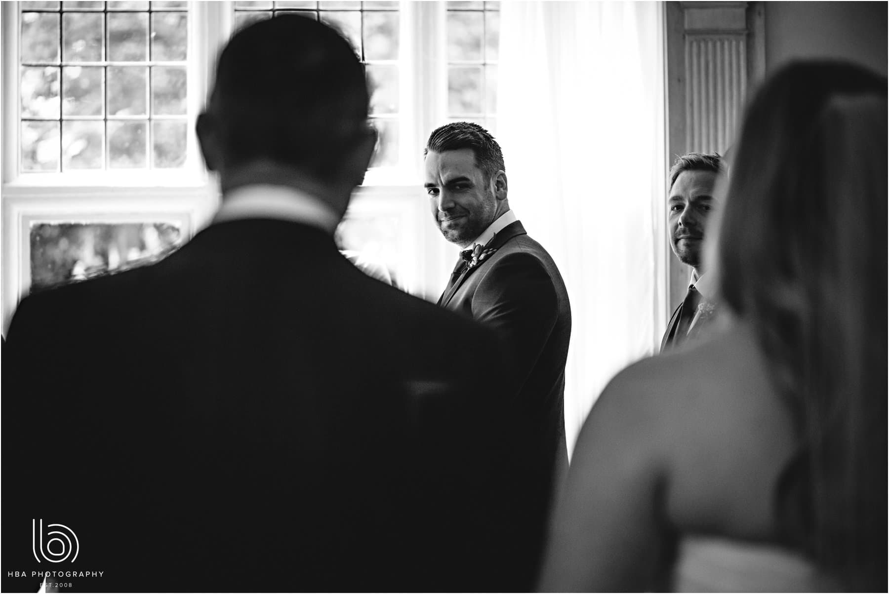 the grooms face as the bride walks down the aisle