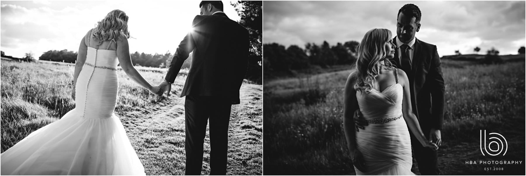 The bride & groom walking in the field