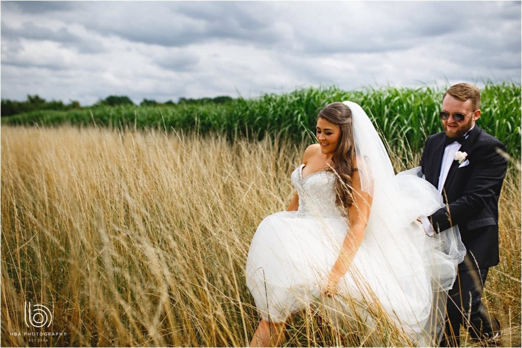 the bride & groom in the corn field