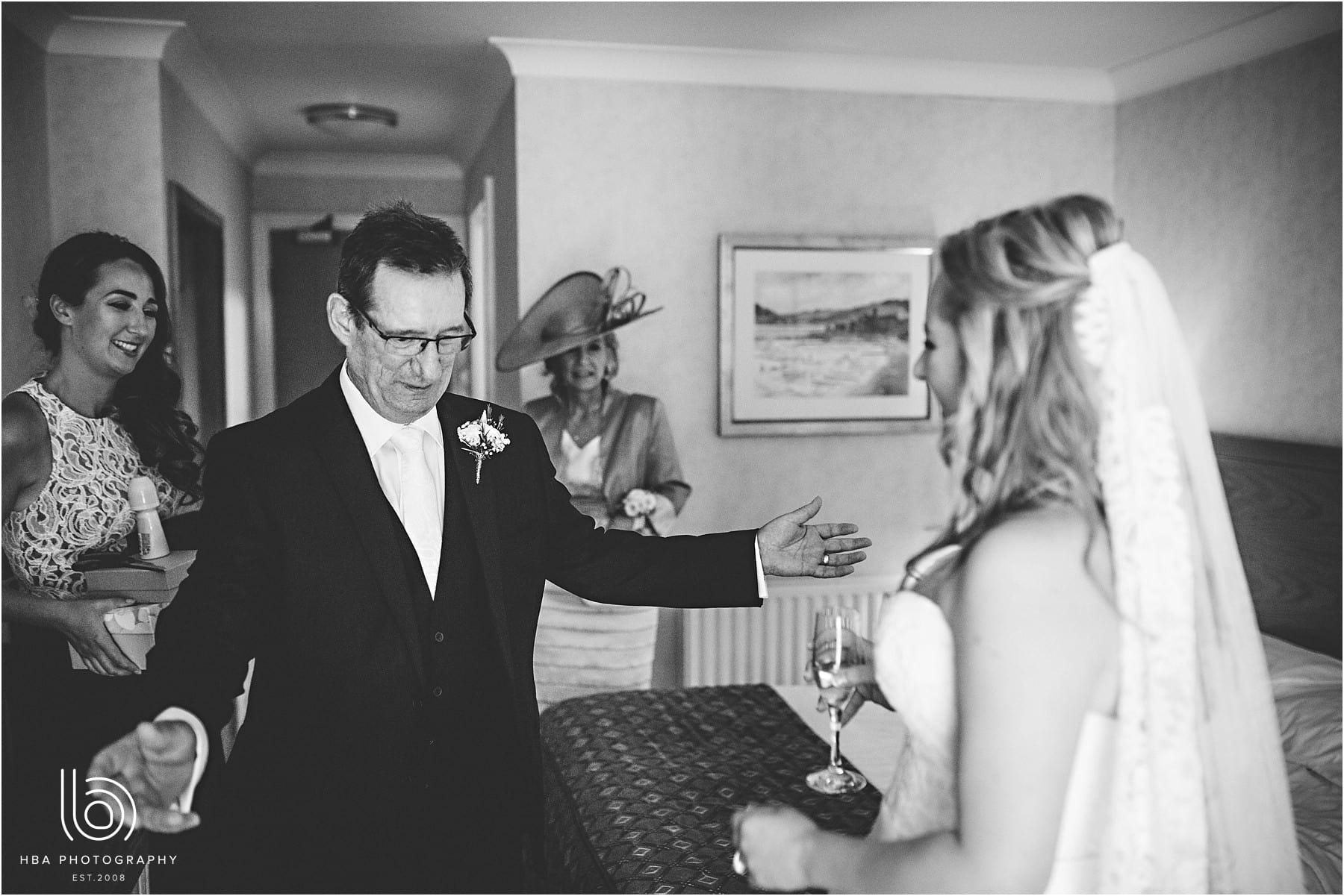 the father of the bride seeing his daughter for the first time