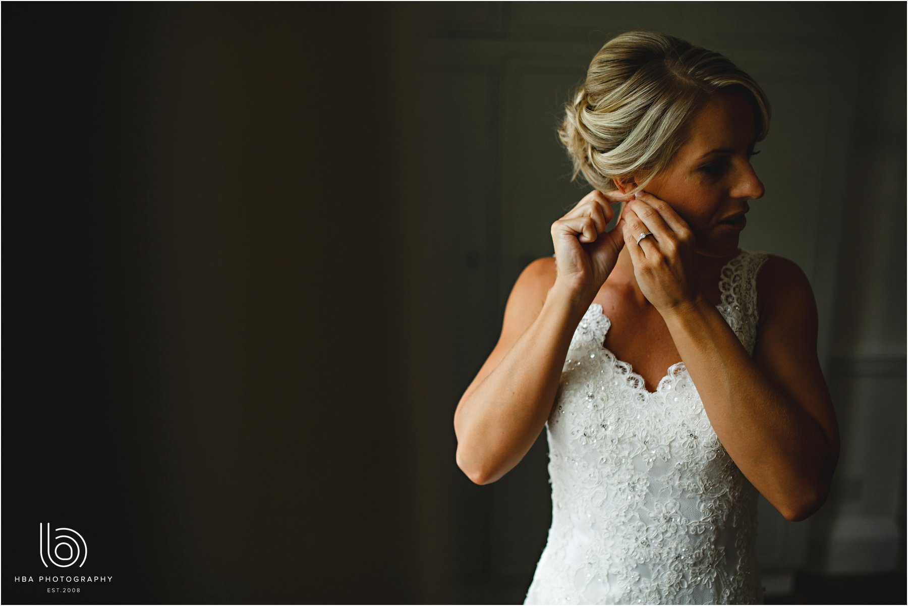 the bride putting her earings in