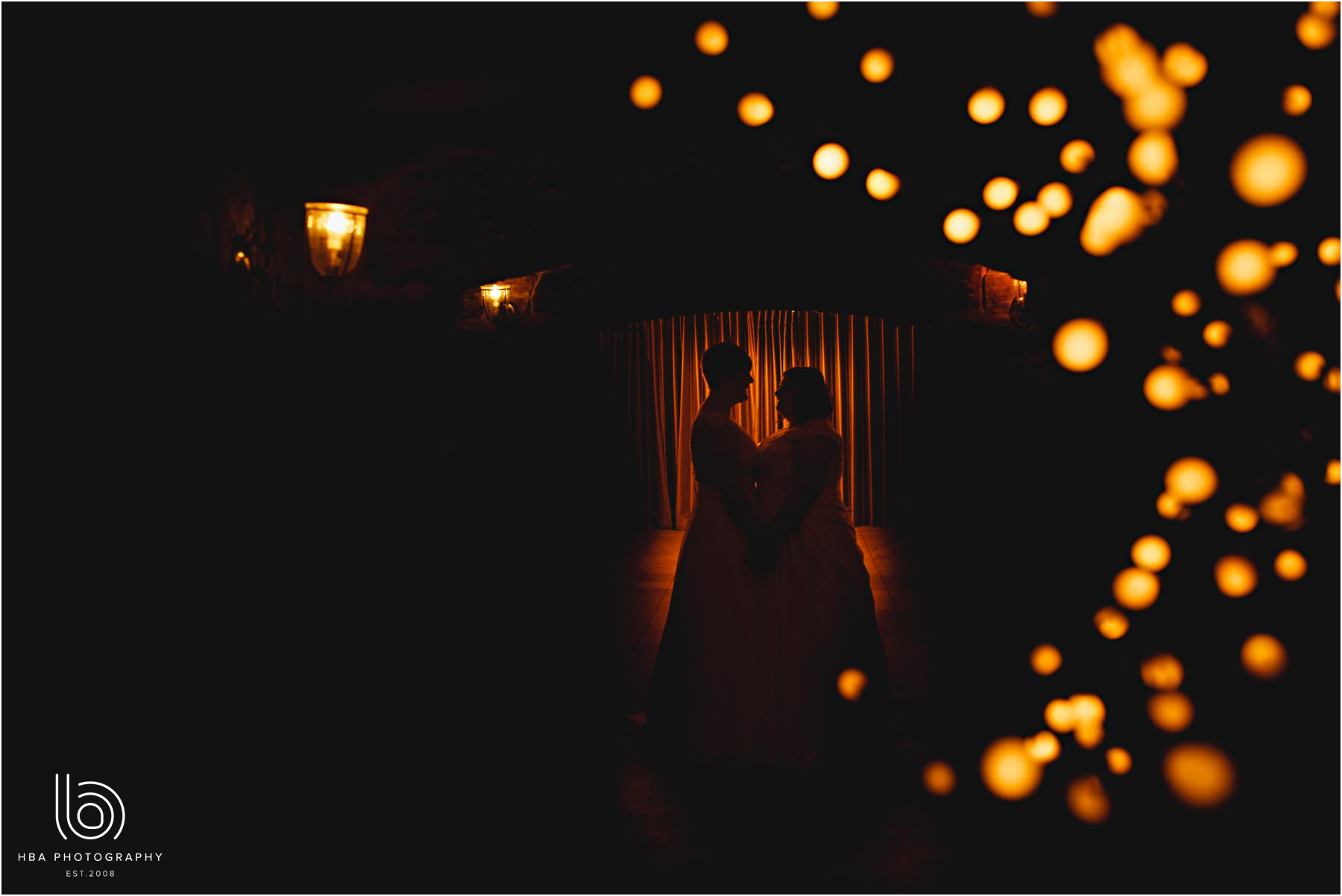 the two brides in the fairy lights