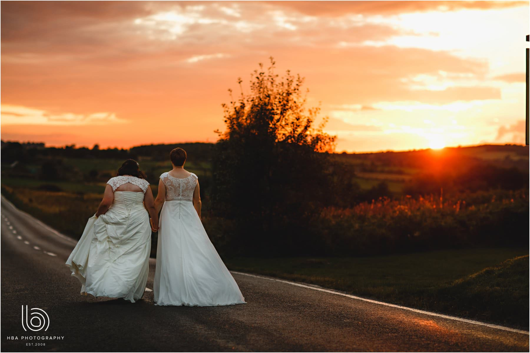 the two brides at sunset