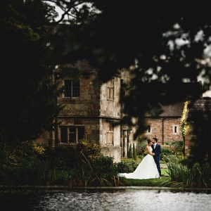 the bride & groom across the lake