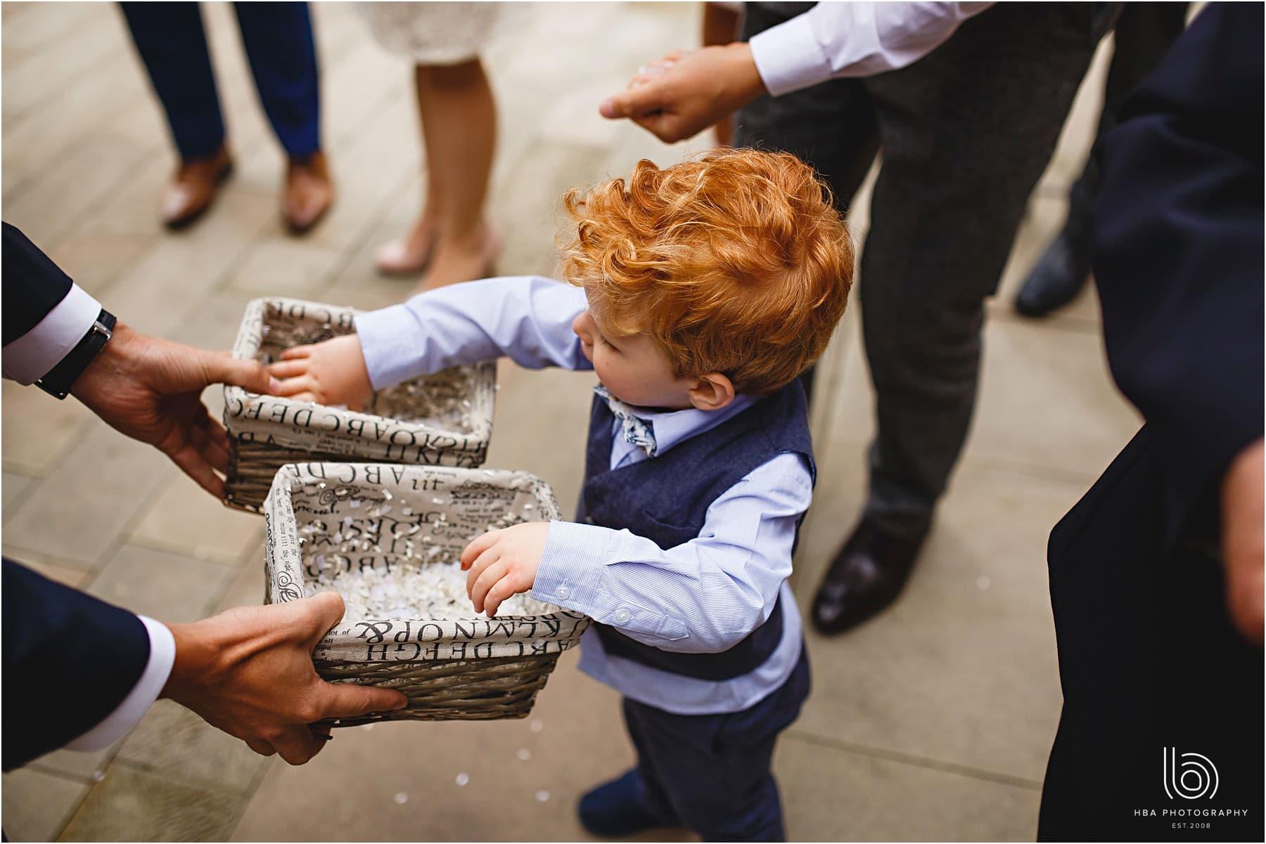 a little boy grabbing confetti
