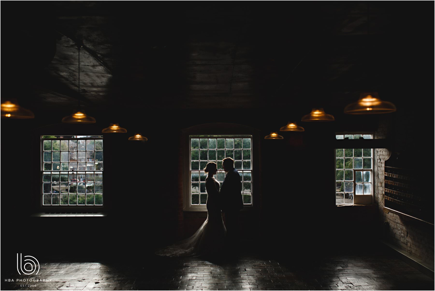 the bride & groom inside the west mill