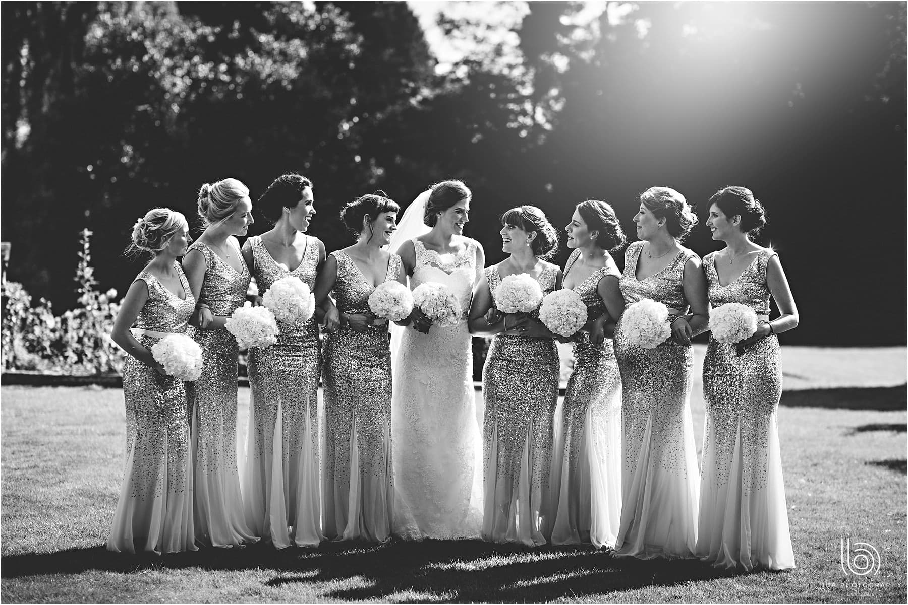 the bride and her amny bridesmaids