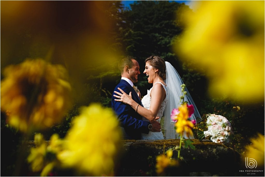 the bride & groom in the flowers and one of derbyshire's premier wedding venues