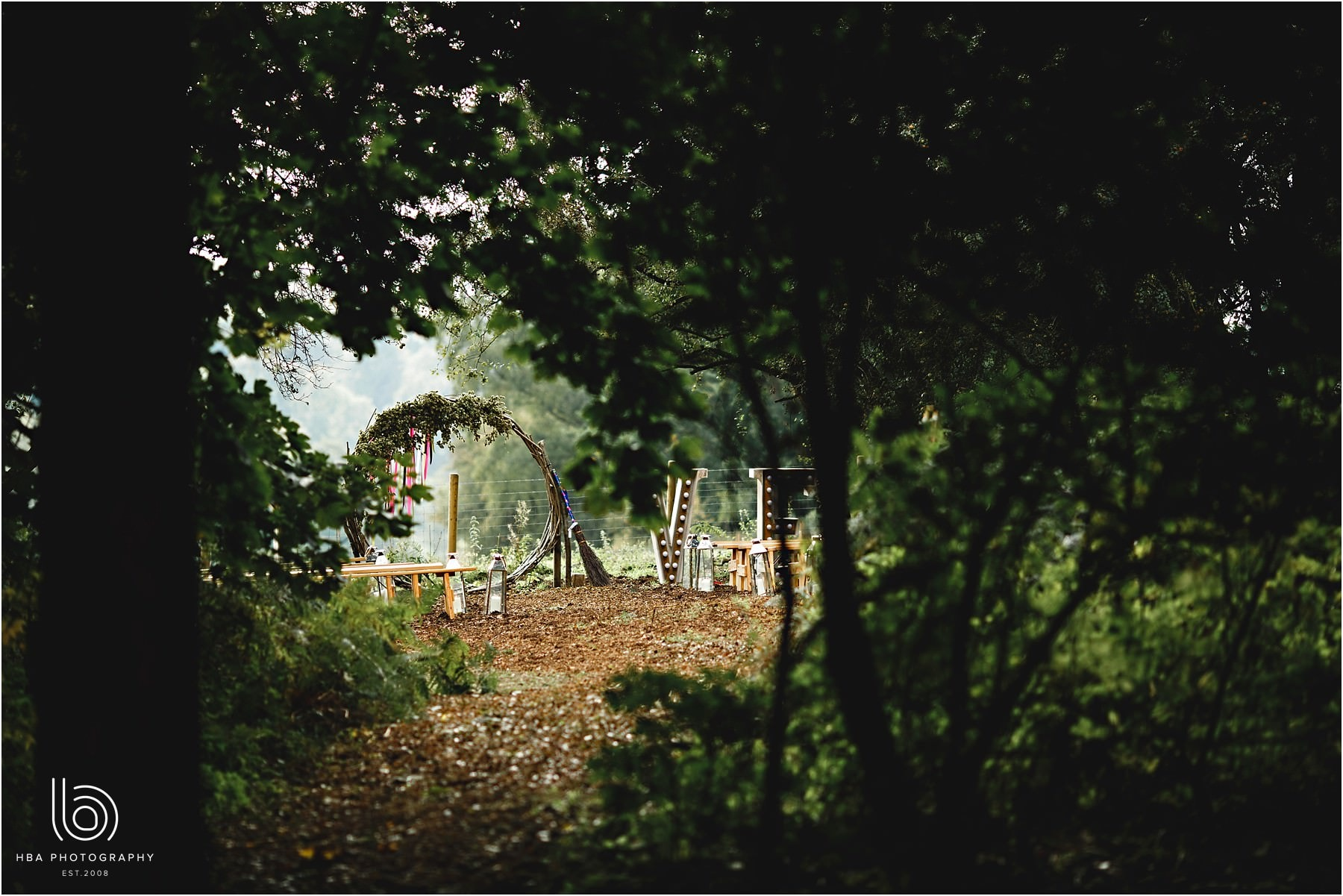 An outdoor woodland wedding ceremony site