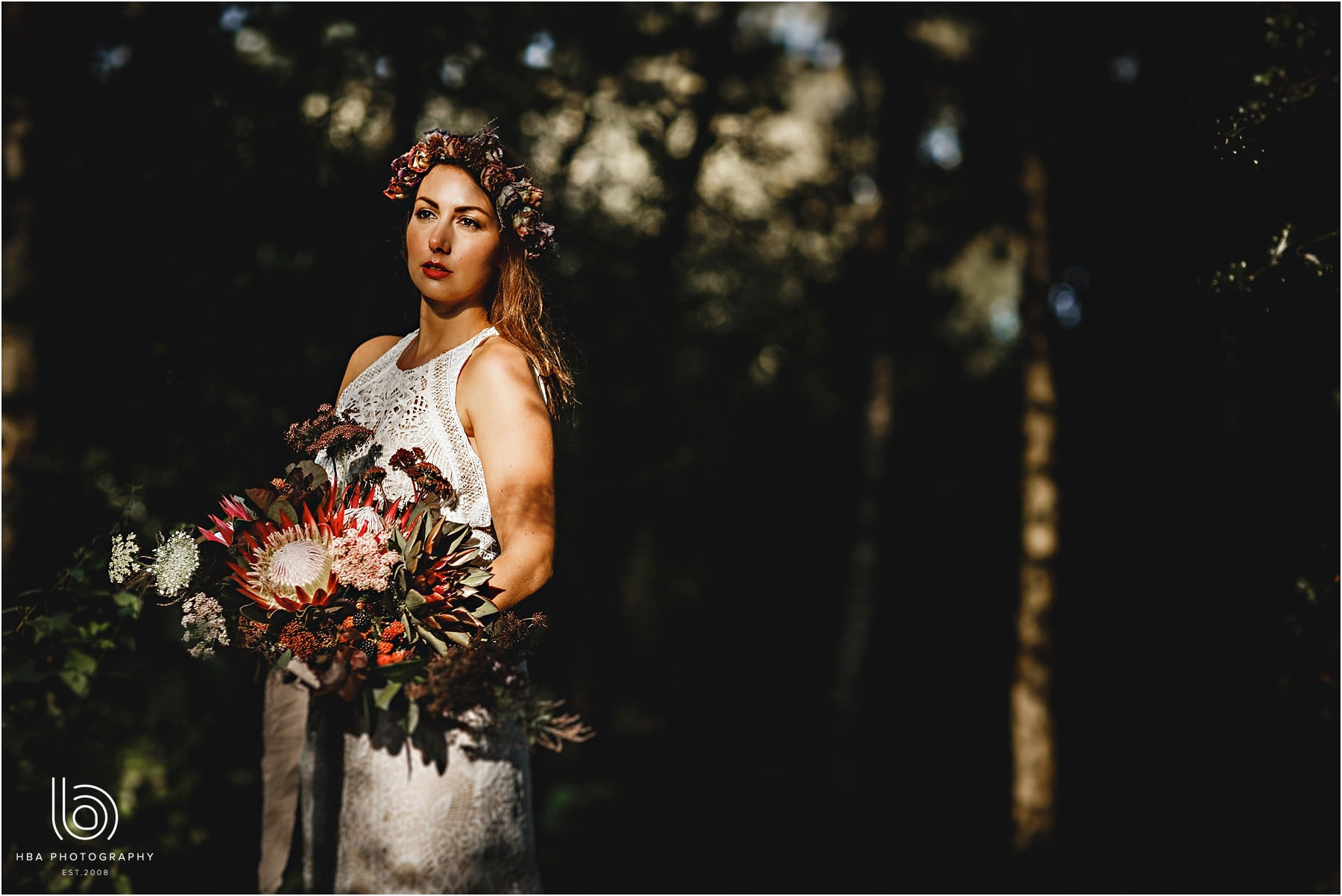 The bride and dappled sunlight in the woods
