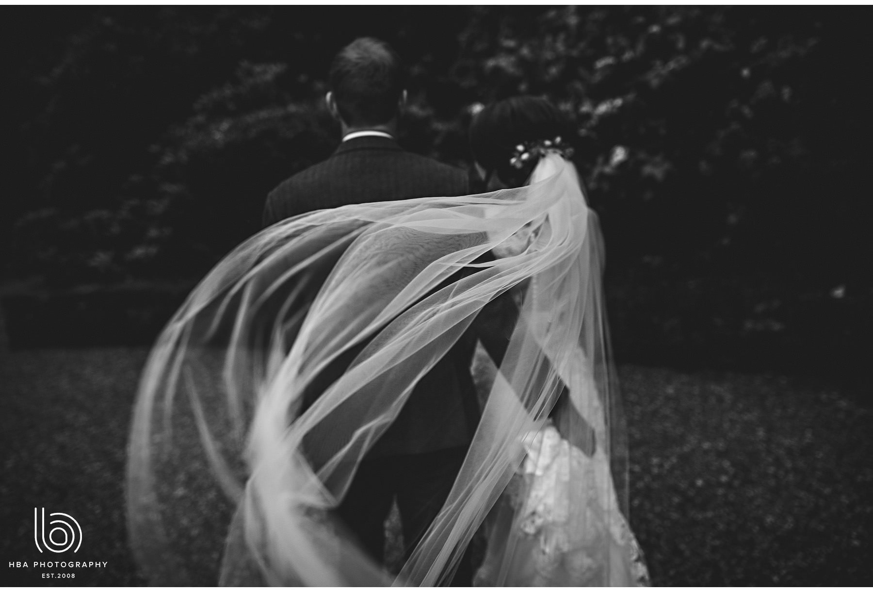the bride's veil blowing in the wind
