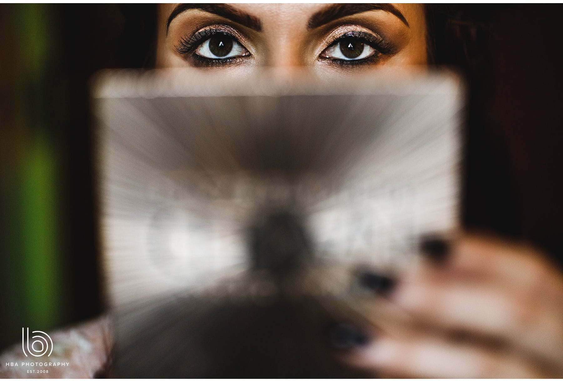 the bride's eyes over her mirror