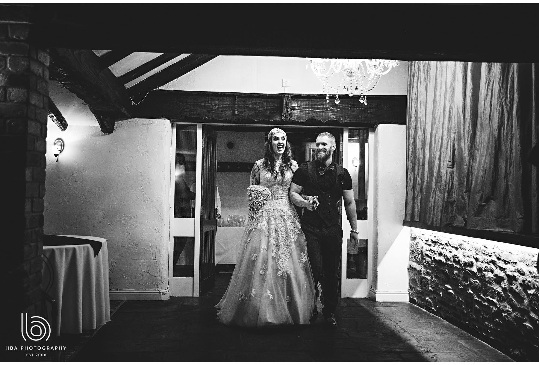 the bride & groom walking into the ceremony