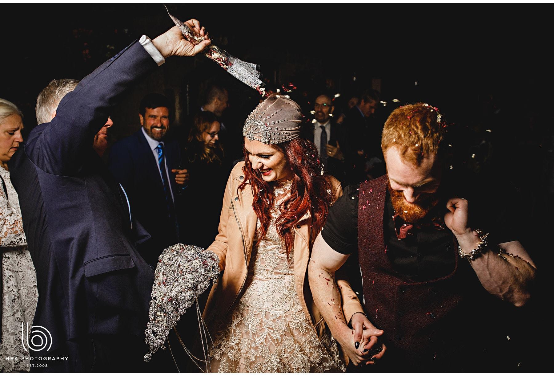 the bride & groom getting confetti'ed!