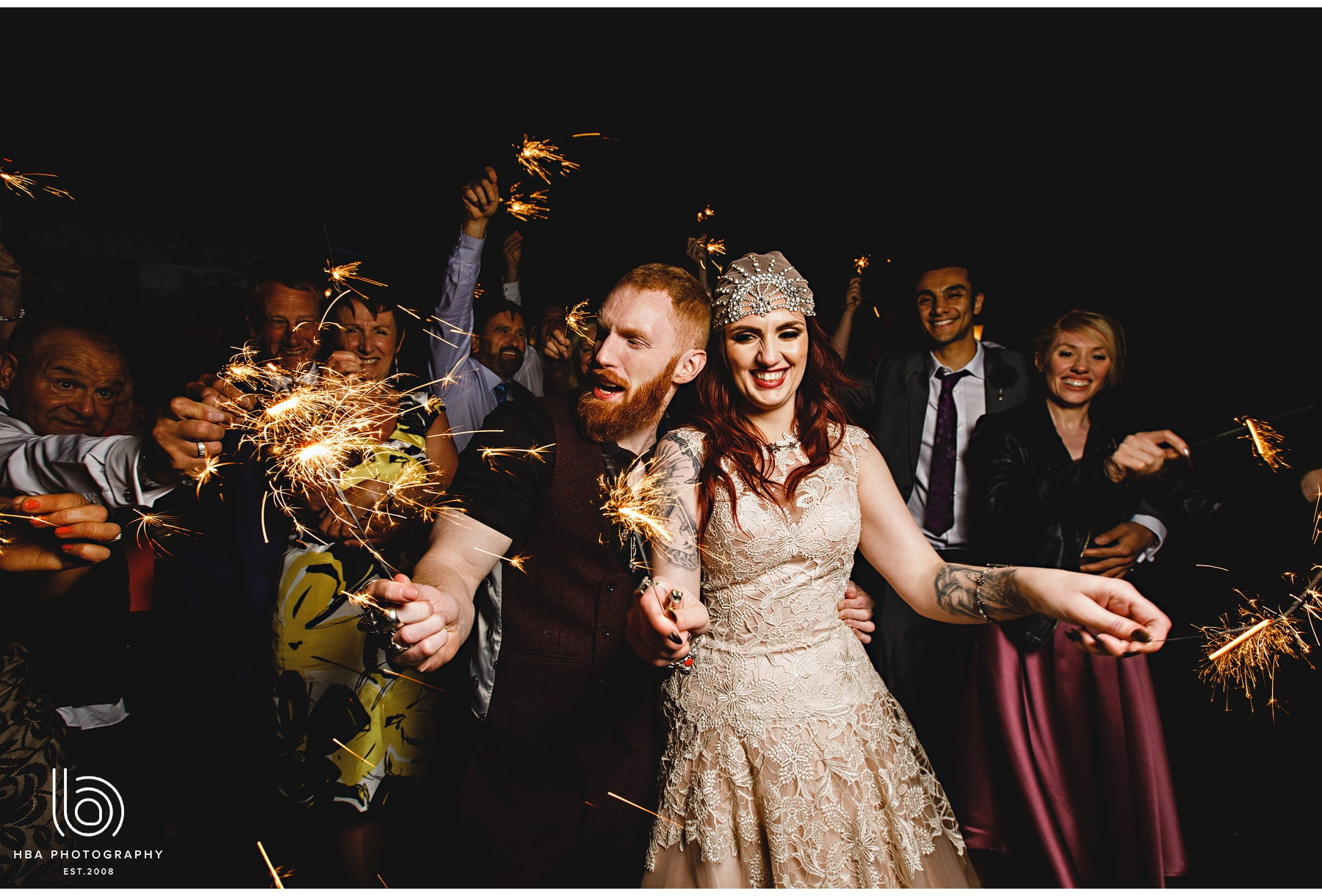 the bride & groom with sparklers