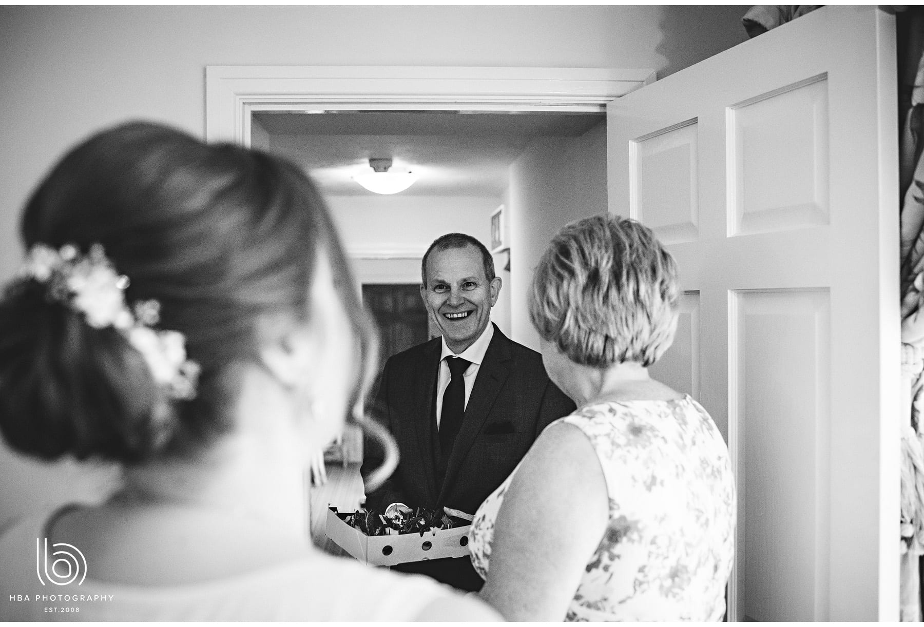 dad seeing his daughter for the first time as a bride