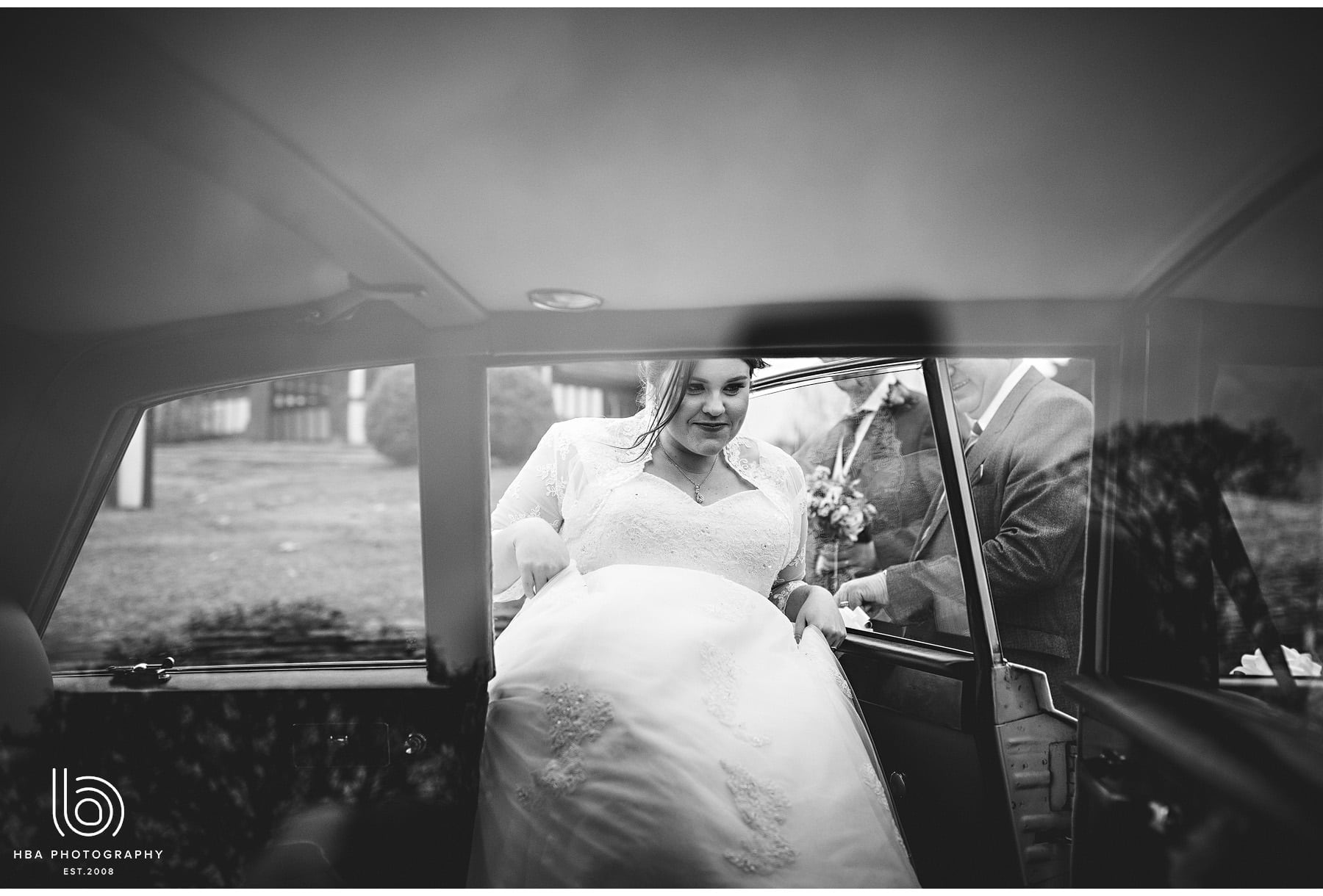 the bride getting into the car