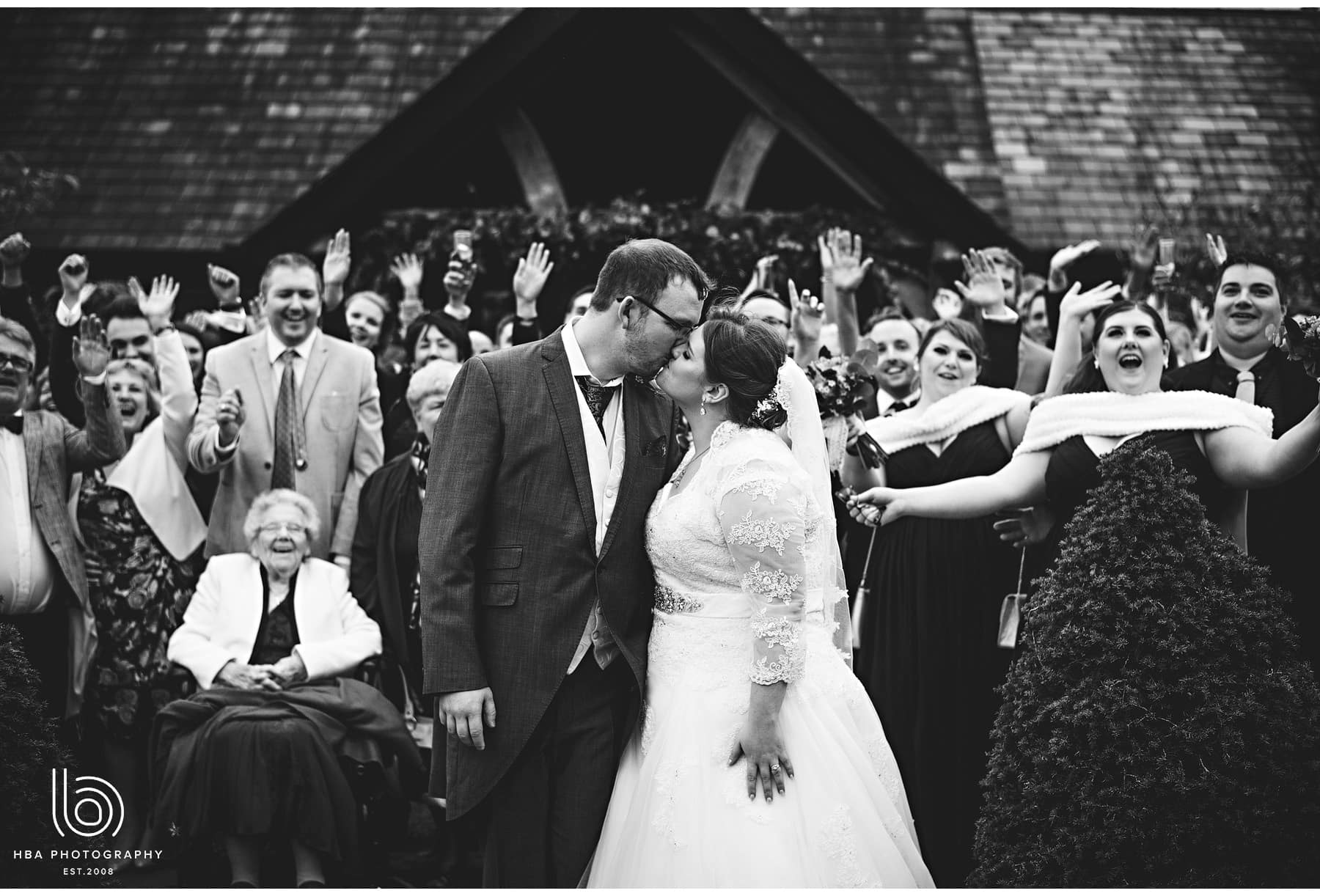 the bride & groom kissing