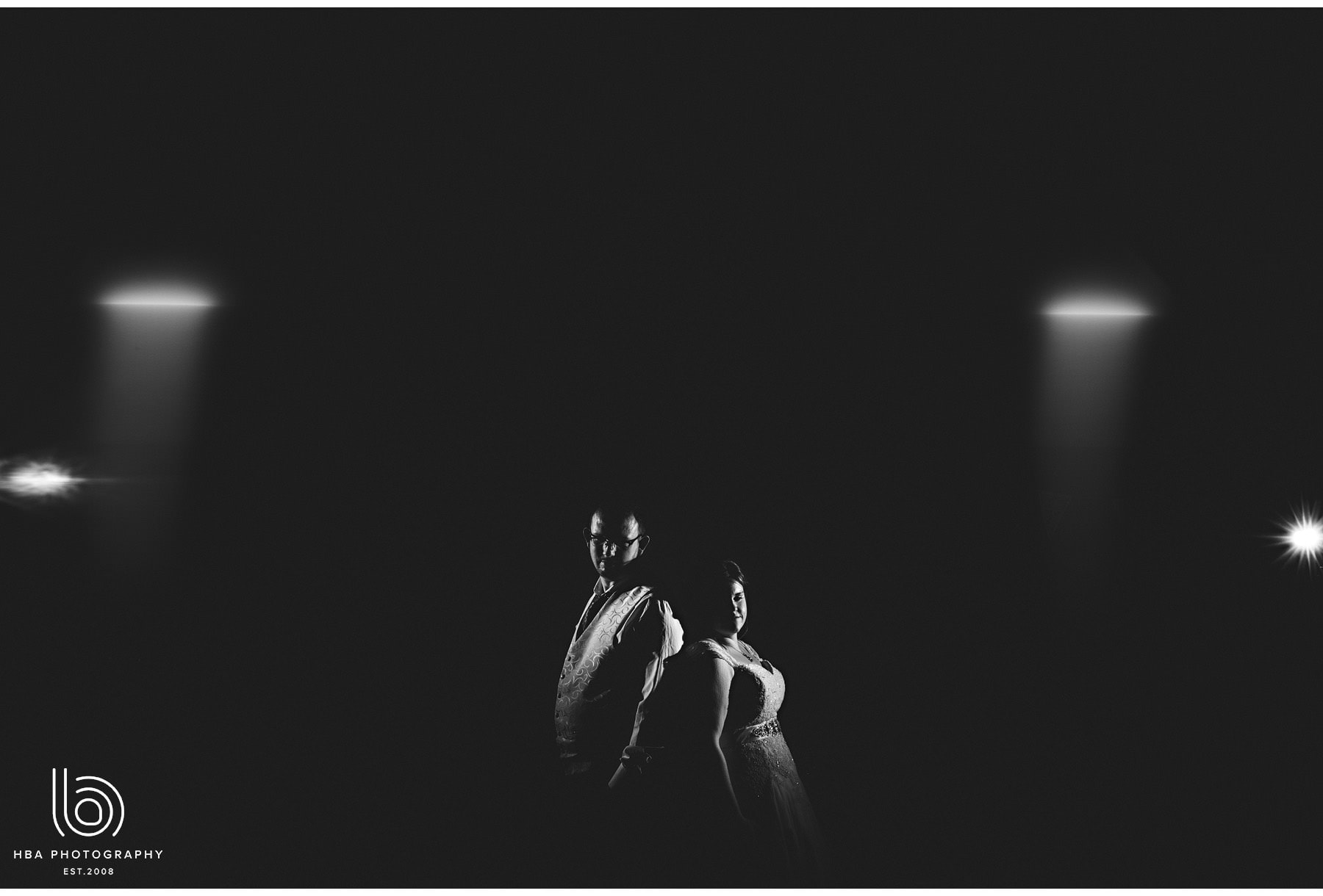 the bride & groom in the darkness